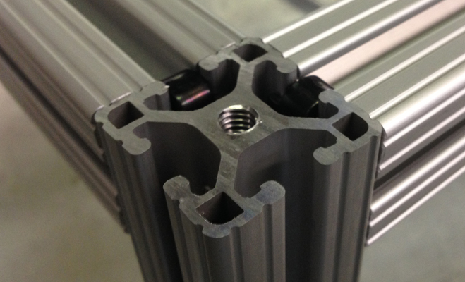 An Aluminum Extrusion corner joined together with end fasteners.